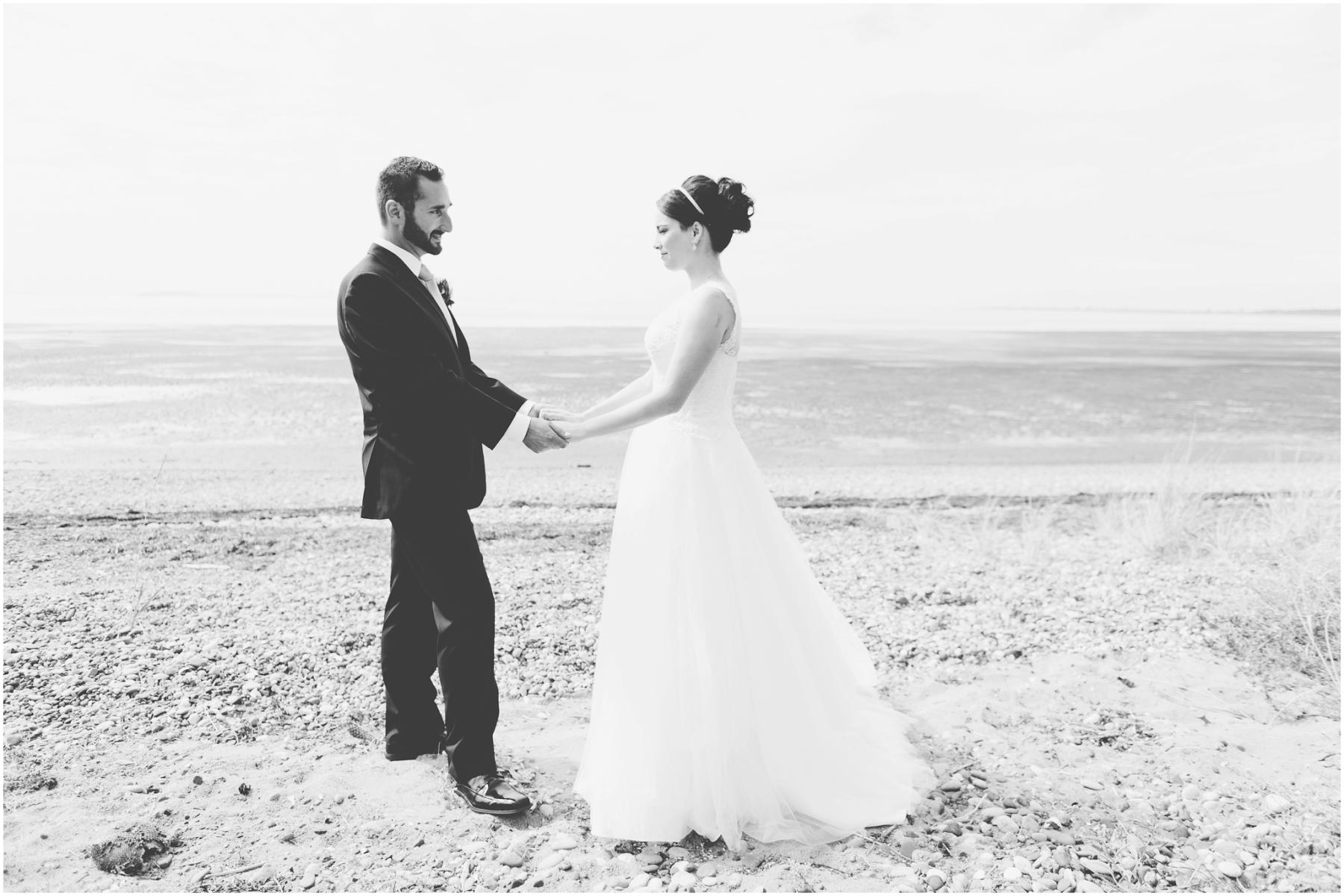 Bride and groom first look on the beach in Bellingham