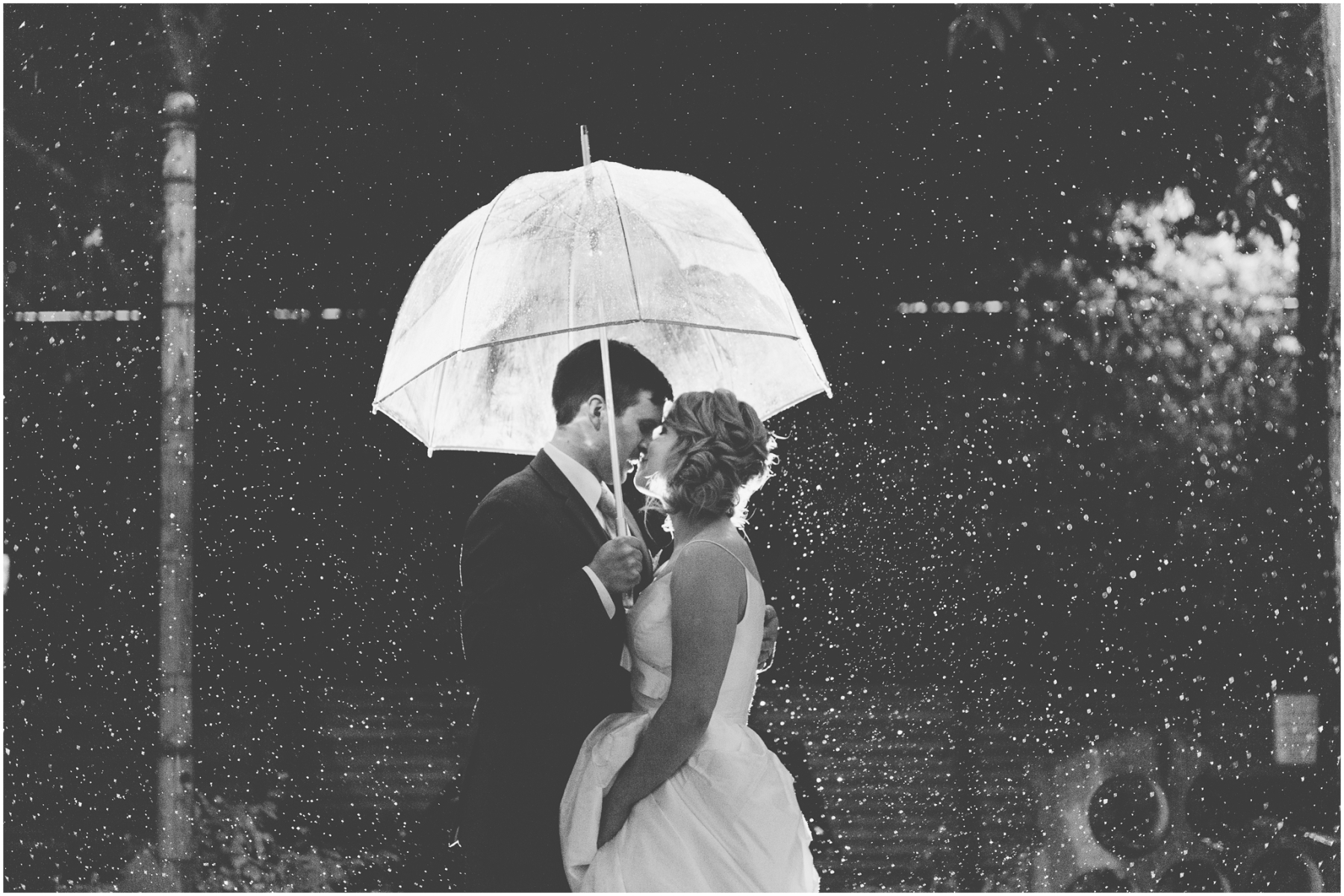 Bride and groom photo in the rain at the Fremont Foundry in Seattle. Image captured by Ardita Kola Photography.